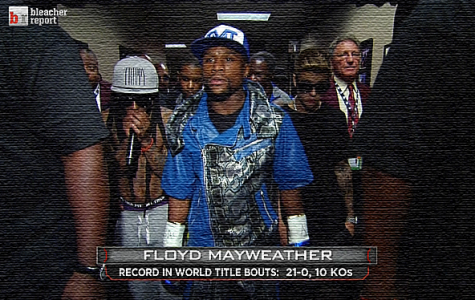 Floyd Mayweather walks out to the ring with Lil' Wayne and Justin Bieber by his side