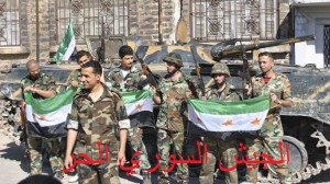During the civil war, many of al-Assad's soldiers have defected and joined the rebel Free Syrian Army. These ex-Syrian Army soldiers are pictured holding an FSA flag.