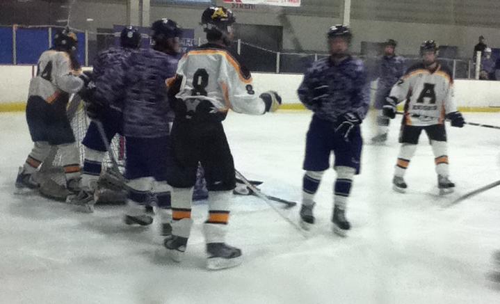 Elder+varsity+hockey+salutes+the+U.S.+Military+vs.+Alter