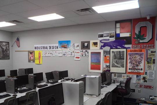 Notice how bright the walls (and hanging items) are in Mr. Buetsche's room with the new LED lights installed.