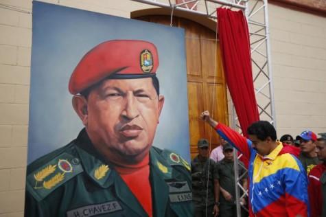 President Nicolas Maduro salutes the deceased former president Hugo Chavez