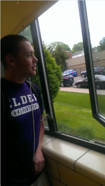 Sam Hauer gazes outside before another tough day of school