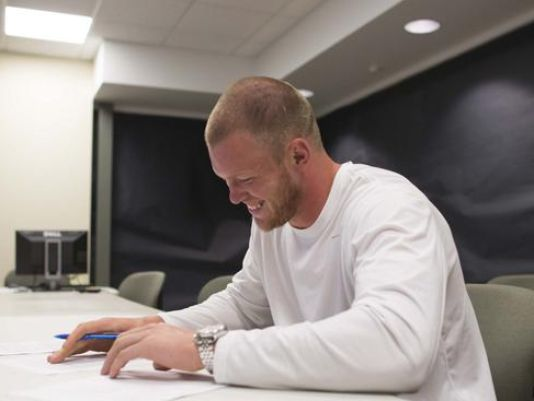 Viking tight end and Elder grad, Kyle Rudolph signs his new NFL contract, and has decided to give a portion to improve Elder's weight room improvements.