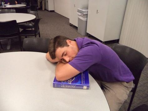 Senior Ryne Poli dozing off in the library