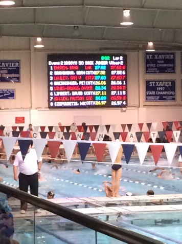 The scoreboard after the 50 Back race.  Sophomore Kelley finished 3rd with a :26.89 time.  Credit: Alex Harrison/@PantherQuill