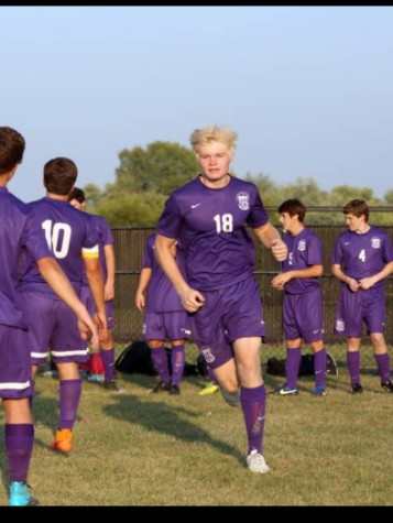 Mitch makes his way out to the pitch for his first Varsity Soccer match.