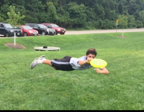 "Jake Helpinstine makes beautiful diving grab while posing the ""limp"""