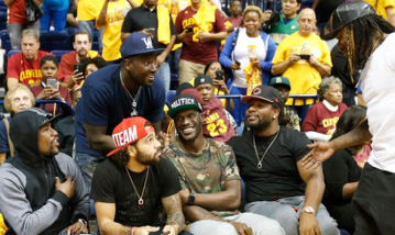 Celebrities Floyd Mayweather, Wallace Gilberry, Vontaze Burfict, Greg Little, and Adam Jones take in the NBA preseason action; photo courtesy of the Cincinnati Enquirer.