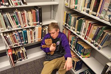 Mike was also seen sleeping with his bear in his favorite spot, the library.