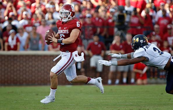 NORMAN, OK - SEPTEMBER 5: Quarterback Baker Mayfield #6 of the Oklahoma Sooners looks to throw under pressure from defensive lineman Jamal Marcus #34 of the Akron Zips September 5, 2015 at Gaylord Family-Oklahoma Memorial Stadium in Norman, Oklahoma.  (Photo by Brett Deering/Getty Images)
