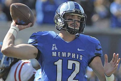 Paxton Lynch throwing a pass in a game against Ole Miss