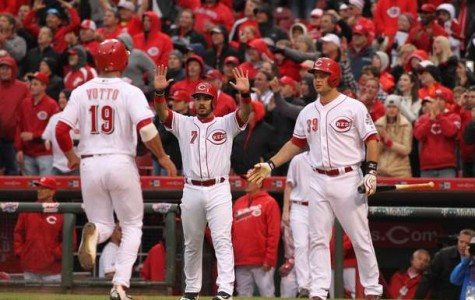 Joey Votta, Devin Mesoraco, and Eugenio Suarez celebrate at home plate during Opening Day