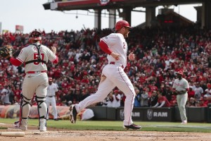 Zack Cozart had three hits and a sacrifice during the Reds 6-2 win on Opening Day over the Phillies