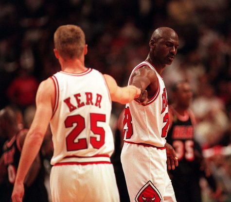 Kerr and Jordan exchange fists in a friendly manor
