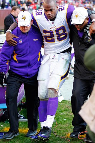 Adrian Peterson being carried off the field with a torn meniscus.