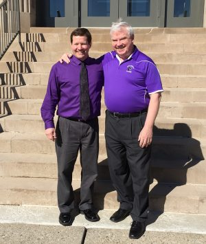 Mr. Ruffing and Mr. Otten posing for pictures after the announcement of Elder's new Principal