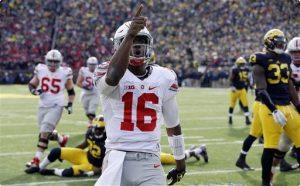 J.T. celebrating touchdown in 42-13 win against Michigan in 2015.