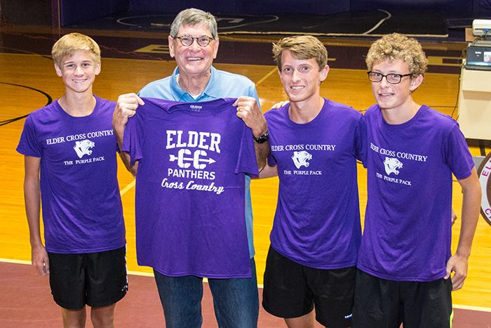The captains of Elder's Cross Country team giving Jim Ryun an Elder Cross Country shirt.