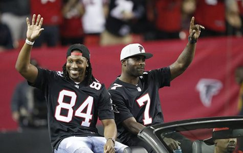 Vick rides in a Mustang, alongside Roddy White, in his return to the Georgia Dome in January 2017