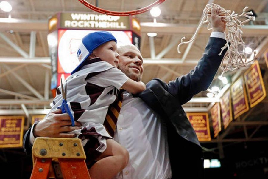Coach Kelsey and son Johnny Ballgame cut down the net