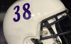 Elder football attempts to prevent concussions with new helmet covers