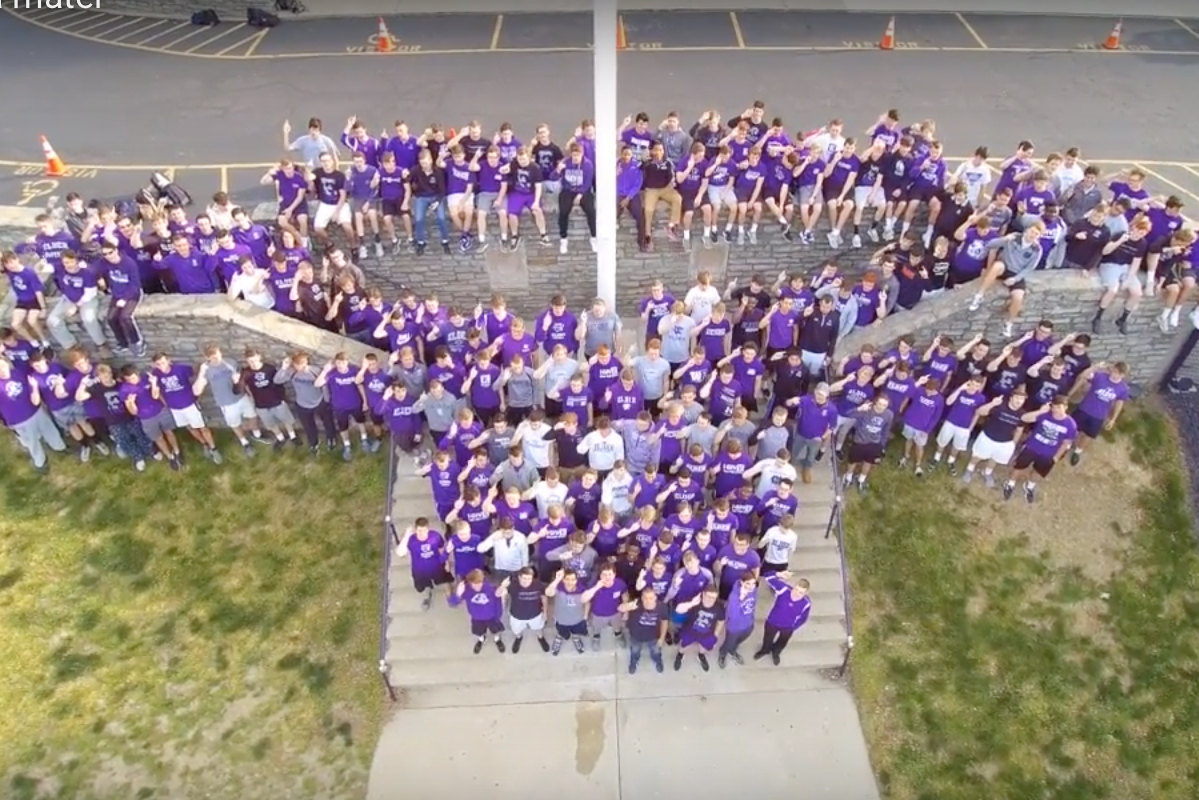 Drone view of the seniors of 2018 singing the Elder Alma Mater on the steps to the Pit.