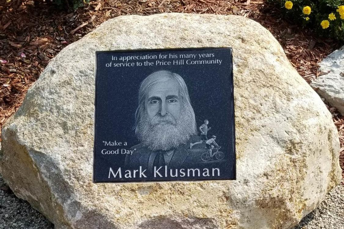 Memorial rock with Klusman picture in the center