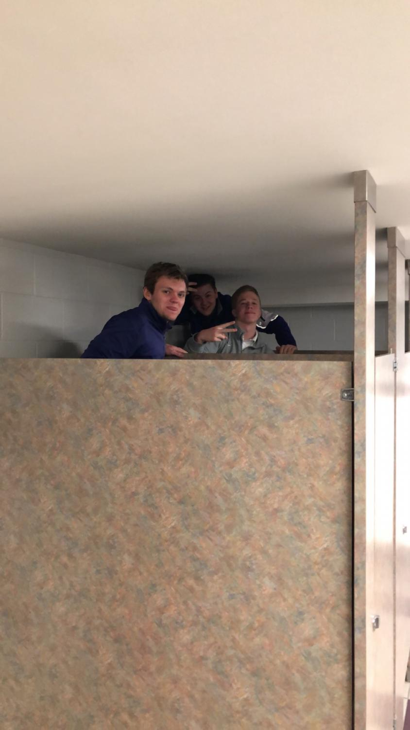 Gunnar+Wall%2C+Brody+Tebbe%2C+and+Jake+Macenko+taking+in+the+%231+ranked+bathroom+in+the+school.