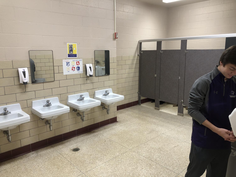 Matt+Allison+dries+off+hands+after+an+eventful+trip+to+the+2nd+Floor+Bathroom.+