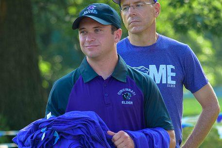 Mr. Quatman hands out jerseys at the Alumni race.