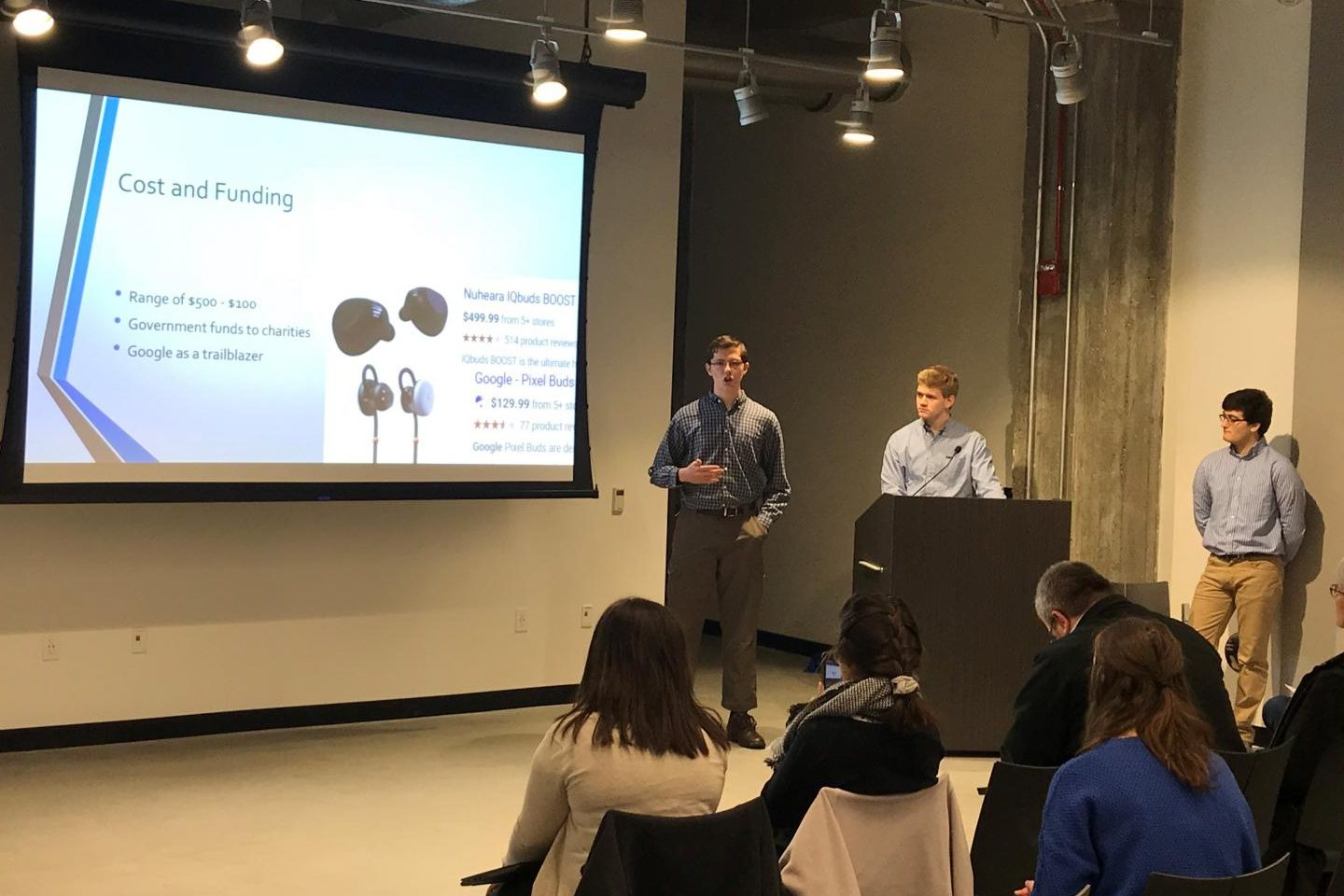Elder students Zach Sargetn, A.J. Tepe and Ethan Rao pitch their proposal for Babelfish earbuds to business leaders from P&G and Kroger.