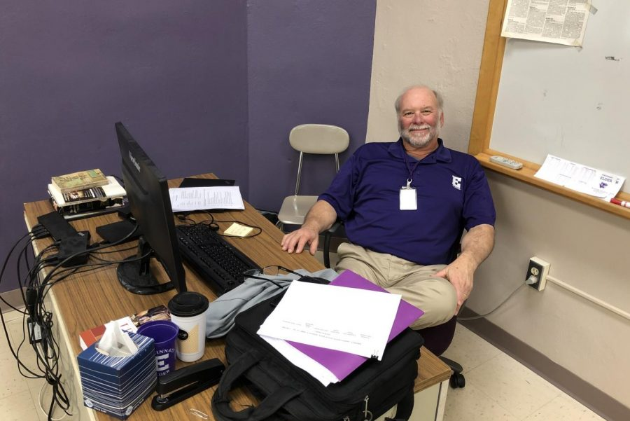 Mr. Auer sitting at his temporary desk in Mr. Bell's room