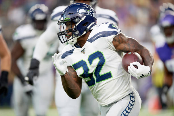 MINNEAPOLIS, MN - AUGUST 18: Chris Carson #32 of the Seattle Seahawks carries the ball against the Minnesota Vikings during the preseason game at U.S. Bank Stadium on August 18, 2019 in Minneapolis, Minnesota. The Vikings defeated the Seahawks 25-19. (Photo by Hannah Foslien/Getty Images)