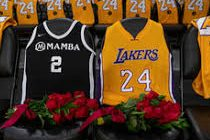 Lakers honor both Kobe and Gianna by laying out their jerseys courtside.