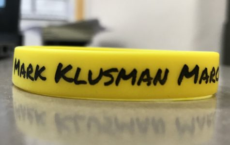 The wristbands bought and wore by the students who are participating by growing out their beards.