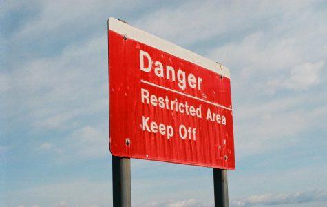 Keep off sign on the break wall of Walnut Beach.