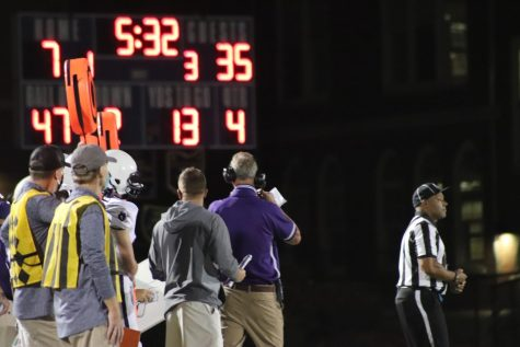 Coach Ramsey glances at the scoreboard with 5:32 left in the game