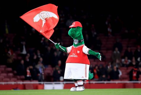 Gunnersaurus doing his pregame ritual before the Gunners take the pitch.