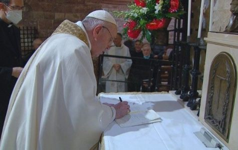 Pope Francis signs his newest work