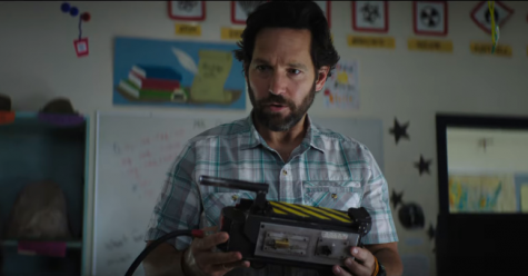 Paul Rudd holds a ghost catcher in 2021 Ghostbusters:Afterlife