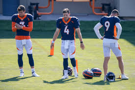 Phot of Broncos quarterbacks via USA today