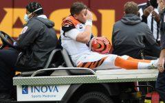 Quarterback Joe Burrow is carted off of the field after his season-ending injury in Week 11.