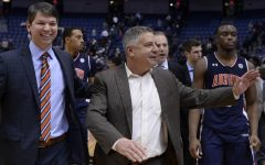 Auburn Coach Bruce Pearl; Auburn placed a self-imposed ban on themselves for the 2021 NCAA tournament.