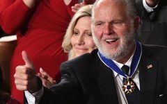 Rush Limbaugh gives a thumbs-up after receiving the Presidential Medal of Freedom from President Donald Trump at the 2020 State of the Union Address.