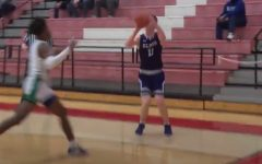 Junior Andrew Harp cans one of his five trifectas en route to 16 points  in the Panthers' victory over Winton Woods.
