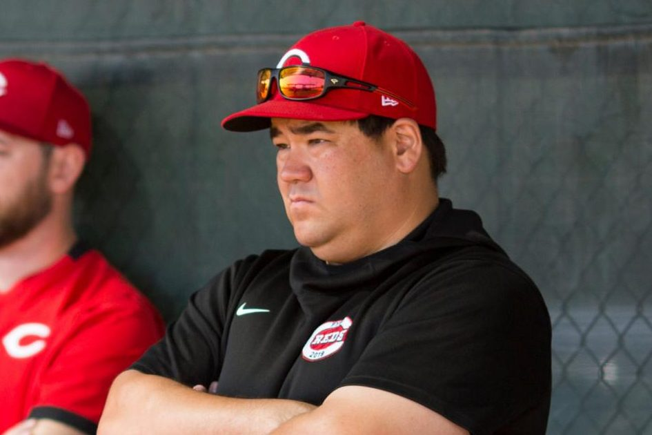 Boddy observes a pitcher from the Reds dugout.